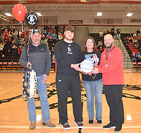 RICK PECK/SPECIAL TO MCDONALD COUNTY PRESS<br /> Athletic Director Bo Bergen presents Cooper Reece with a commemorative basketball prior to the Mustangs' Feb. 21 game against Marshfield noting Reece scoring his 1,000th career point on Jan. 25, at Neosho High School. Also present are Reece's parents, Shane and Angie Reece.