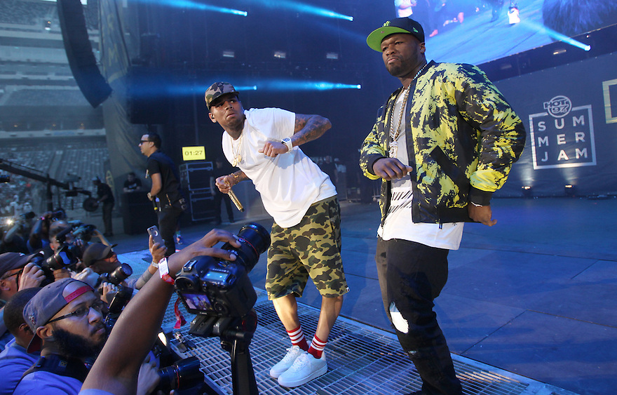 Chris Brown and 50 Cent are seen performing at Hot 97 Summer Jam at MetLife Stadium on Sunday, June 07, 2015, in East Rutherford, New Jersey. (Photo by Donald Traill/Invision/AP)
