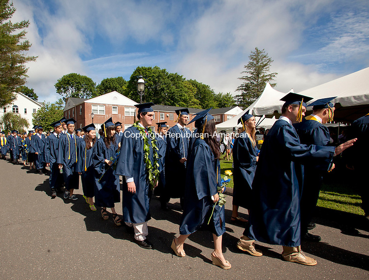 CHESHIRE, CT-8 June 2013-060813BF08-  Graduates make their way into a tent during Cheshire Academy's graduation the campus' Kevin Slaughter Field in Cheshire. Bob Falcetti Republican-American