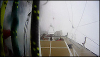 BNPS.co.uk (01202 558833)<br /> Pic: ClipperRace/BNPS <br /> <br /> ***Please Use Full Byline***<br /> <br /> The Great Britain is thrown over as the storm passes over head.  <br /> <br /> This is the heart-stopping moment two British sailors are washed off the side of a yacht as it is knocked flat by a tornado in the middle of the ocean.<br /> Sarah Usher and Liz Richards are seen desperately trying to grab hold of the 70ft boat as they are swept overboard when the freak weather conditions hit.<br /> Their 70ft yacht was blown onto one side as the wind built then smashed almost 180 degrees onto the other as the tornado struck.<br /> Winds of more than 115mph pinned the capsized yacht down for around 60 seconds.<br /> Dramatic footage of the ordeal shows the boat's crew dragging the pair out of the water and back on board the boat as the winds ease.<br /> The tornado can then be seen disappearing into the distance as the boat returns to upright.<br /> Sarah, 34, from Hull, East Yorks, and Liz, 65, from Dartmouth, Devon, were both wearing life jackets at the time and were shaken but uninjured in the ordeal.<br /> They were part of an 18-strong crew on the Great Britain yacht competing in the Clipper Round the World Race, a 40,000-mile yacht race for amateur sailors.