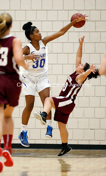 Waterbury, CT- 08 January 2016-010816CM04-  Crosby's Destin Trammell blocks the shot of Torrington's Alexis Tyrell during their NVL matchup in Waterbury on Friday.    Christopher Massa Republican-American