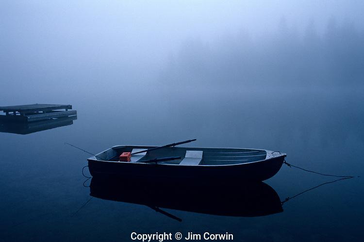 Row boat on Lake Mason, sunrise in fog, Olympic Penninsula, Washington State USA.