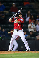 Tripp Martin (9) of the Hickory Crawdads at bat against the Kannapolis Intimidators at L.P. Frans Stadium on April 23, 2015 in Hickory, North Carolina.  The Crawdads defeated the Intimidators 3-2 in 10 innings.  (Brian Westerholt/Four Seam Images)