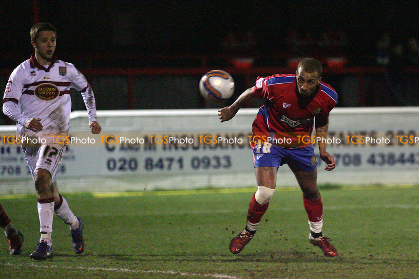Josh Parker of Dagenham goes close with a header at the death -  Dagenham and Redbridge vs Northampton - at the Emirates Stadium - 13/03/12 - MANDATORY CREDIT: Dave Simpson/TGSPHOTO - Self billing applies where appropriate - 0845 094 6026 - contact@tgsphoto.co.uk - NO UNPAID USE.