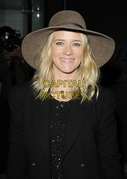 EDITH BOWMAN.At the Macmillan De'Longhi Art Auction 2010, Avenue restaurant, London, England, UK, September 28th 2010..half length black coat brown hat floppy seventies 70's gold necklaces smiling felt .CAP/CAN.©Can Nguyen/Capital Pictures.