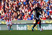 9th September 2017, bet365 Stadium, Stoke-on-Trent, England; EPL Premier League football, Stoke City versus Manchester United; Paul Pogba of Manchester United is watched by Xherdan Shaqiri of Stoke City