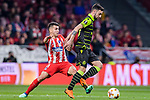 Angel Correa of Atletico de Madrid (L) fights for the ball with Bruno Fernandes of Sporting CP (R) during the UEFA Europa League quarter final leg one match between Atletico Madrid and Sporting CP at Wanda Metropolitano on April 5, 2018 in Madrid, Spain. Photo by Diego Souto / Power Sport Images