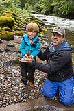 USA, Oregon, Santiam River, Brown Cannon, a young boy showing off the fish he caught in the Santiam River