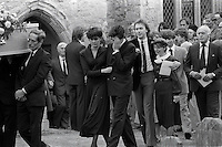 Pix: Copyright Anglia Press Agency/Archived via SWpix.com. The Bamber Killings. August 1985. Murders of Neville and June Bamber, daughter Sheila Caffell and her twin boys. Jeremy Bamber convicted of killings serving life...copyright photograph>>Anglia Press Agency>>07811 267 706>>..Jeremy Bamber is comforted by his girlfriend Julie Mugford at the funeral of his family, alongside Colin Caffell, father and husband of victims. no date..ref 0006 neg 14