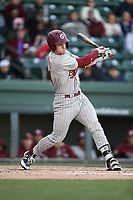 Catcher Luke Berryhill (14) of the South Carolina Gamecocks bats in a game against the Furman Paladins on Tuesday, March 19, 2019, at Fluor Field at the West End in Greenville, South Carolina. South Carolina won, 12-7. (Tom Priddy/Four Seam Images)