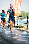A swimmer runs toward the transition area at Delpha-Sauvé Park.