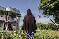 "Indonesia – Sumatra – Banda Aceh – Lampaseh – 49-year-old Yusnida looks at the remains of  a villa destroyed by the tsunami where she was stranded for a few minutes between the second and the third wave before the stream brought her to the open sea. An oyster collector and the mother of three children, two of whom were killed by the waves, Yusnida spent almost twelve hours at sea during the tsunami, floating thanks to a pair of plastic containers under her armpits. She was collected in the evening by some fishermen, who gave her clothes and brought her to a nearby hospital, where she spent the following six months recovering from several injuries. Yusnida was able to return to her new house two years after the tsunami, only to find the atmosphere of the village dramatically changed. The thousands of people who died had been replaced by several newcomers, who Yusnida felt could never understand the tragedy of what had happened. ""In the first year after the tsunami I used to ask myself 'Why did I survive? Wasn't it better to go together with my sons?'"