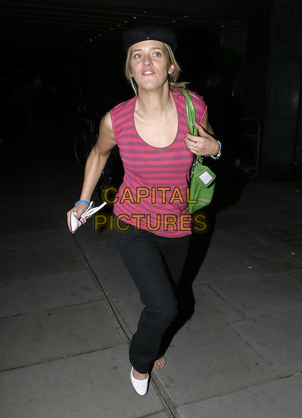EDITH BOWMAN.At the official Pre-Brit Awards 2005 Pool Tournament,.The Garden, Sanderson Hotel, London, .February 8th 2005..full length hat cap long red pink striped vest top green bag white shoes one shoe off carrying shoe funny.Ref: AH.www.capitalpictures.com.sales@capitalpictures.com.©Capital Pictures.