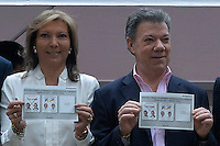 BOGOTA, Colombia. 15th June 2014. The President of Colombia Juan Manuel Santos (R ) shows his vote next to his wife María Clemencia Rodríguez de Santos during the runoff for presidential election in Bogota. Photo by Campaign/Javier Casella / VIEWpress TO EDITORS : THIS PICTURE WAS PROVIDED BY A THIRD PARTY.  THIS PICTURE IS DISTRIBUTED EXACTLY AS RECEIVED BY VIEWpress, AS A SERVICE TO CLIENTS