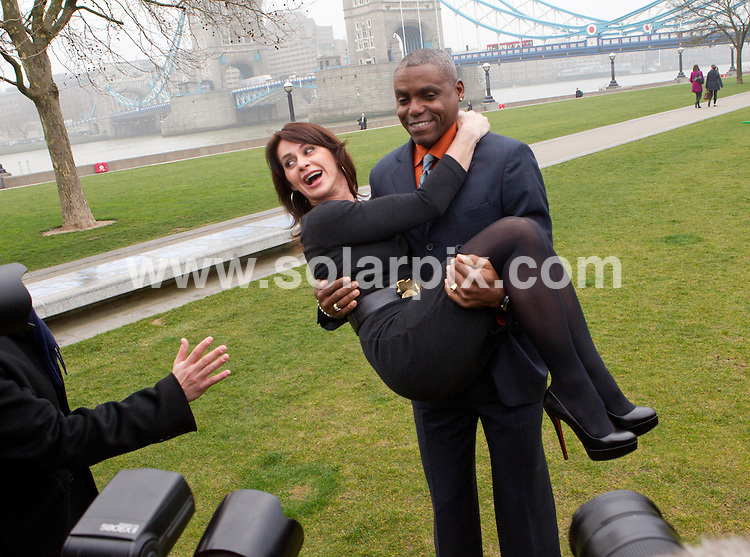 **ALL ROUND PICTURES FROM SOLARPIX.COM**                                             **NO UK NEWSPAPER PUBLICATION**.**UK MAGAZINE & SUPPLEMENT PUBLICATION ONLY** AND NO PUBLICATION IN AUSTRALIA, BELGIUM, FRANCE, GERMANY, ITALY, SCANDINAVIA AND USA**                                                                                  Caption: Legendary Olympians Nadia Comaneci, Carl Lewis and Rebecca Adlington joined Seb Coe and Boris Johnson at a photocall in London this morning to  mark exactly 500 days to go until the Opening Ceremony of London 2012 and the day that the application process opens for tickets to the Olympic Games                                                                              .This pic:  Nadia Comaneci and Carl Lewis                                                                                             JOB REF: 12974       SFE       DATE:  15.03.2011                                                          **MUST CREDIT SOLARPIX.COM OR DOUBLE FEE WILL BE CHARGED**                                                                      **MUST AGREE FEE BEFORE ONLINE USAGE**                               **CALL US ON: +34 952 811 768 or LOW RATE FROM UK 0844 617 7637**