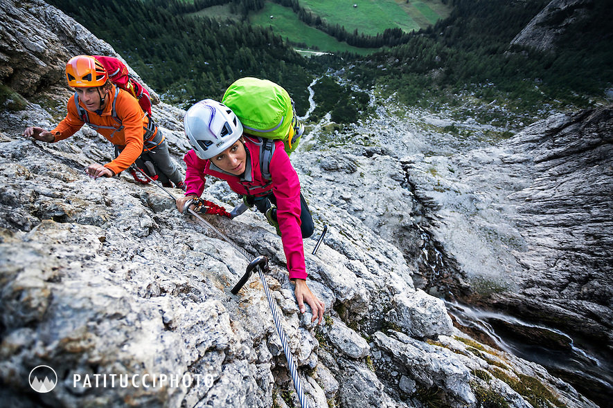 Couple climbing the Dolomites Via Ferrata Tridentina while on the Alta Via 2
