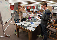 From left, Anna Misenti '17, Theresa Edwards '18, Jacob Bartenbach '18 (yawns), Rosie Yasukochi '18 and Jeremy Bloom '18 study for their Econ 101 final in the Academic Commons on Friday. Students study for finals in the Academic Commons, Dec. 12, 2014. (Photo by Marc Campos, Occidental College Photographer)