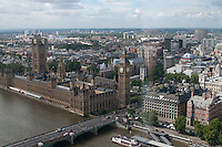 View of Big Ben and the Houses of Parliament from the top.  The London Eye on the Southbank of the River Thames in London.  Stands 135 metres tall and carries 3.5 million visitors each year.  Conceived and designed by David Marks & Julia Barfield, it took 7 years to design & build and involved products made by specialists in 5 countries.   It was originally sponsored by British Airways, who ran it from 2000 until 2005, when it was known as the Millenium Wheel.