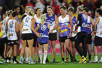 Players huddle after an exhibition match featuring local cross-code stars at aftime during the Australian Rules Football ANZAC Day match between St Kilda Saints and Sydney Swans at Westpac Stadium, Wellington, New Zealand on Thursday, 24 May 2013. Photo: Dave Lintott / lintottphoto.co.nz