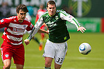 04/14/2011 - Kenny Cooper pushes down field as the Portland Timbers play FC Dallas during the Portland Timbers' second MLS home match at Jeld-Wen Field Sunday.  ..Photo by Christopher Onstott