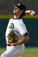 Starting pitcher Blake Whitney (14) of the University of South Carolina Upstate Spartans delivers a pitch in a game against the Kennesaw State Owls on Thursday, March 29, 2018, at Cleveland S. Harley Park in Spartanburg, South Carolina. (Tom Priddy/Four Seam Images)