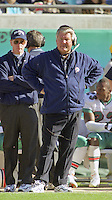 Coach Jimmy Johnson watches from the sidelines during the final game of the legendary quarterback Dan Marino, a 62 to 7 Playoff loss by his Miami Dolphins tot he Jacksonville Jaguars in Alltell Stadium, Jacksonville, FL, January 15, 2000.  It was also the final game of Johnson's coaching career in Miami.  (Photo by Brian Cleary/www.bcpix.com)
