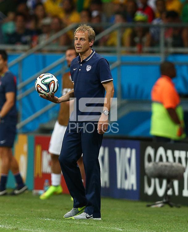 USA coach Juergen Klinsmann holds the match ball