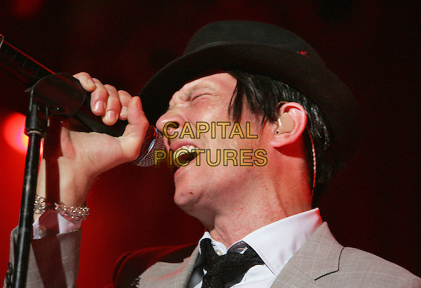 SCOTT WEILAND.performs live during his solo tour at HOB Anaheim in Anaheim, California, USA, May 23rd 2009..music concert gig show on stage performing portrait headshot black hat shirt tie microphone singing                                              .CAP/DVS.©DVS/RockinExposures/Capital Pictures