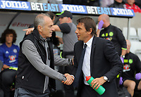 (L-R) Francesco Guidolin, Manager of Swansea City greets Manager of Chelsea, Antonio Conte during the Premier League match between Swansea City and Chelsea at The Liberty Stadium on September 11, 2016 in Swansea, Wales.