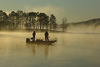 Bass anglers casting at dawn on Lake Greeson near Kirby, Arkansas