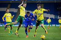 Nathaniel Mendez-Laing of Cardiff City gets between Marco Stiepermann and Timm Klose of Norwich City during the Sky Bet Championship match between Cardiff City and Norwich City at the Cardiff City Stadium, Cardiff, Wales on 1 December 2017. Photo by Mark  Hawkins / PRiME Media Images.