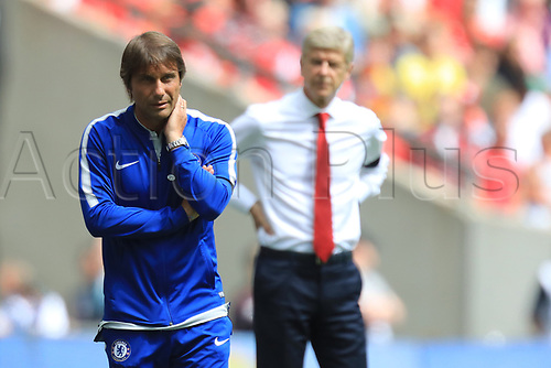 August 6th 2017, Wembley Stadium, London, England; FA Community Shield Final; Arsenal versus Chelsea; Chelsea Manager Antonio Conte in deep thought as Wenger pass behind him