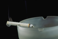 Cigarette smoking in an ashtray. Tobacco, Health, Addiction.