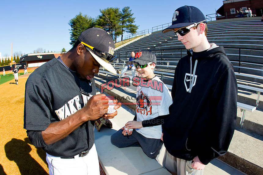 Kevin Jordan (21) of the Wake Forest Demon Deacons signs autographs prior to the game against the North Carolina Tar Heels at Wake Forest Baseball Park on March 9, 2013 in Winston-Salem, North Carolina.  The Tar Heels defeated the Demon Deacons 20-6.  (Brian Westerholt/Four Seam Images)