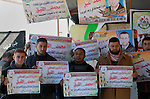 Palestinians take part in a protest to show solidarity with a Palestinian journalist Mohammed al-Qiq who is imprisoned in an Israeli jail at the Erez crossing checkpoint in the northern Gaza Strip on Feb. 04, 2016. Qiq is being held under Israel's controversial administrative detention law, which allows the state to hold suspects for renewable six-month periods without trial and he has been refusing food since November 25 in protest against the ''torture and ill treatment that he was subjected to during interrogation'', according to Addameer, a Palestinian human rights organisation. Photo by Yasser Qudih