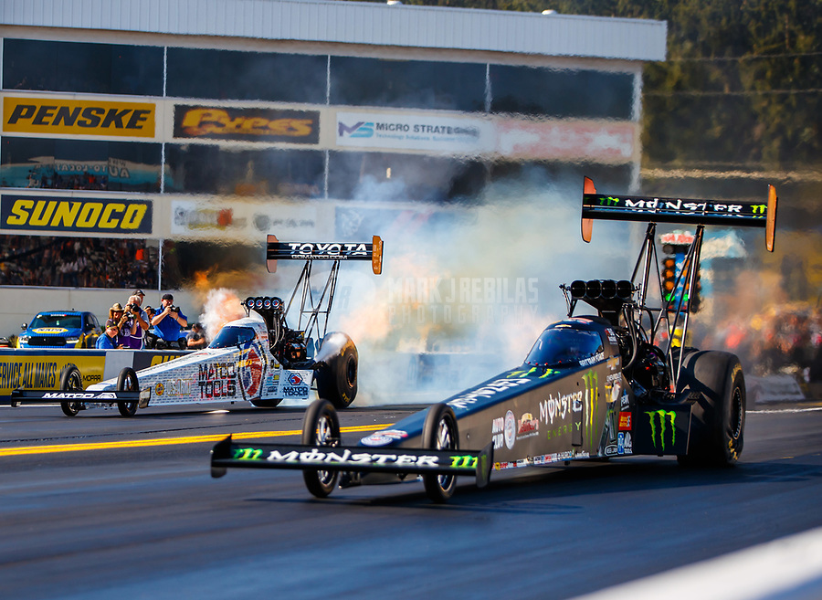 Sep 24, 2017; Mohnton, PA, USA; NHRA top fuel driver Brittany Force (near) defeats Antron Brown during the Dodge Nationals at Maple Grove Raceway. Mandatory Credit: Mark J. Rebilas-USA TODAY Sports