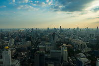 Bangkok panorama from Baiyoke tower at dusk with many skyscrapers in the horizon