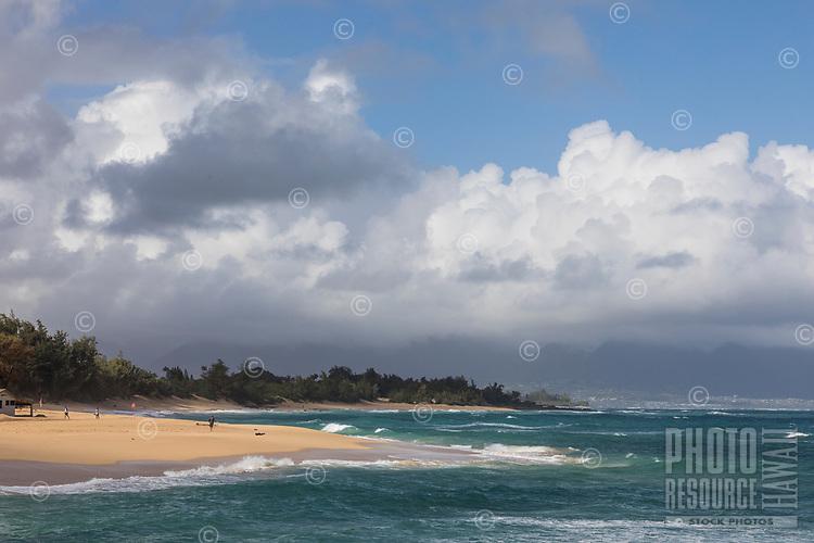 Beachgoers at Baldwin Beach and Pa'ia coastline, Maui.