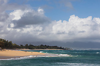 Beachgoers at Baldwin Beach and Pa'ia coastline, Maui.