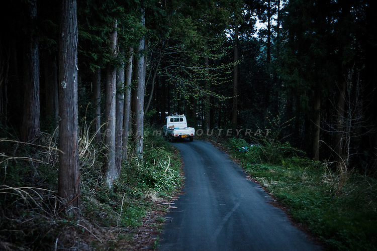 Tomioka, May 2 2012 - Naoto Matsumura, 52, refuses to leave the Fukushima nuclear evacuation zone. Since April 2011, he lives alone in his house without electrcicity and takes care of pets in the area. heading to his house at dusk.