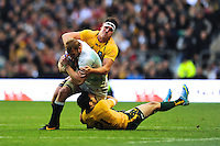 Chris Robshaw of England is tackled by Kane Douglas (left) and Nic White of Australia during the QBE Autumn International match for the Cook Cup between England and Australia at Twickenham on Saturday 2nd November 2013 (Photo by Rob Munro)