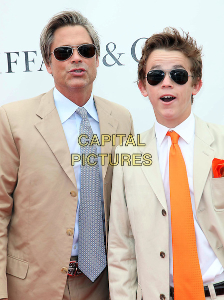 Rob Lowe and son John Owen Lowe.Audi At The Foundation Polo Challenge held at the Santa Barbara Polo & Racquet Club, Santa Barbara, California, USA, 9th July 2011..half length sunglasses father dad family beige brown suit blue shirt tie orange funny mouth open .CAP/ADM/KB.©Kevan Brooks/AdMedia/Capital Pictures.