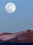 The full moon rises over the Pine Nuts, south of Gardnerville, Nev., on Thursday, April 18, 2019.<br /> Photo by Cathleen Allison/Nevada Momentum
