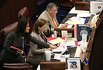 Nevada Senate Assistant Sgt.-at-Arms Teri Peterson hands out paperwork to Senate Republicans Becky Harris and Pete Goicoechea during the final hours of the session at the Legislative Building in Carson City, Nev., on Monday, June 1, 2015. <br /> Photo by Cathleen Allison