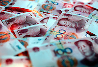 One Hundred Chinese Yuan (RMB) notes displayed for photographs in Shanghai, China..