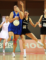 07.08.2010 Silver Ferns Anna Scarlett and Samoa's Monika Fuimaona in action during the Silver Ferns v Samoa netball test match played at Te Rauparaha Arena in Porirua  Wellington. Mandatory Photo Credit ©Michael Bradley.