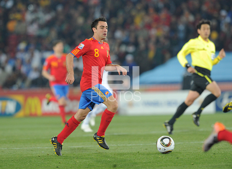 Spanish playmaking midfielder Xavi brings the ball upfield. Spain defeated Honduras, 2-0, in their second match of play in Group H  in a match played Monday, June 21st, at Ellis Park in Johannesburg, South Africa at the 2010 FIFA World Cup..