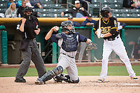 Nevin Ashley (31) of the Colorado Springs Sky Sox and home plate umpire Greg Stanzak during the game against the Salt Lake Bees in Pacific Coast League action at Smith's Ballpark on May 22, 2015 in Salt Lake City, Utah.  (Stephen Smith/Four Seam Images)