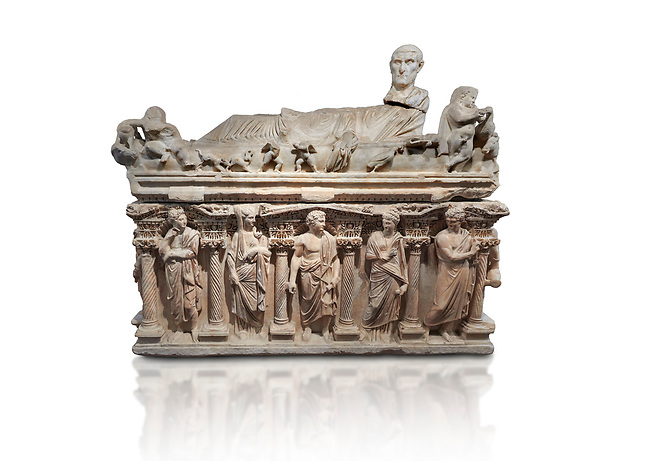 "Roman relief sculpted sarcophagus with kline couch lid with a reclining male figuer depicted, ""Columned Sarcophagi of Asia Minor"" style typical of Sidamara, 3rd Century AD, Konya Archaeological Museum, Turkey. Against a white background."