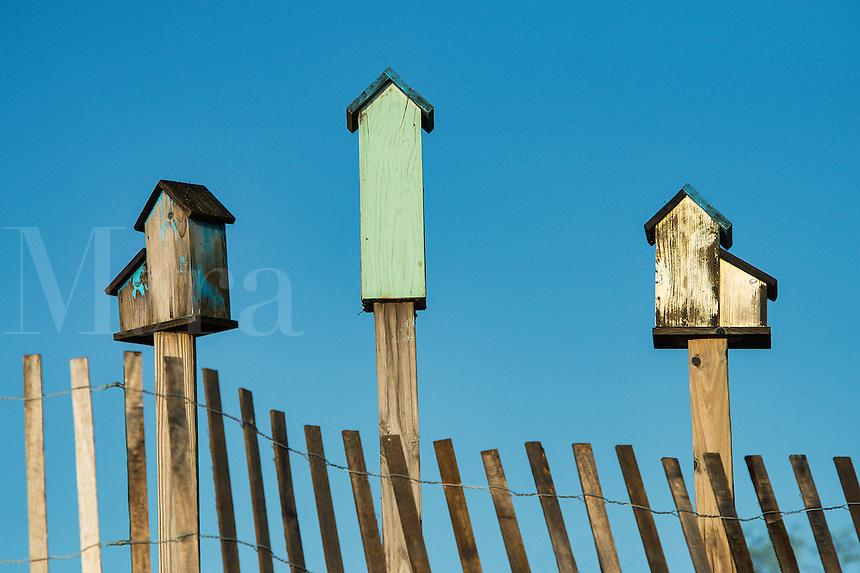 Three birdhouses.